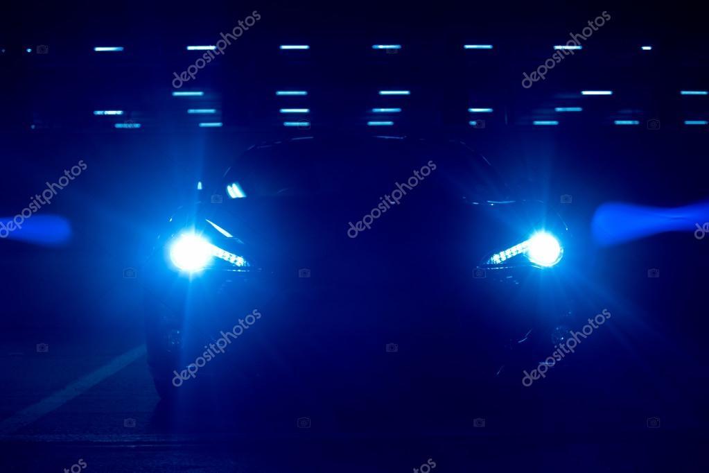 Bright Blue Car Headlights at Night