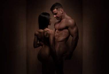 Naked Romantic Bodybuilding Couple in Silhouette