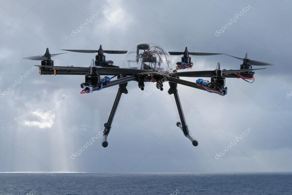 Hexacopter drone flying over the ocean