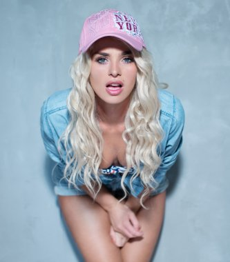 sexy blonde woman wearing pink hat