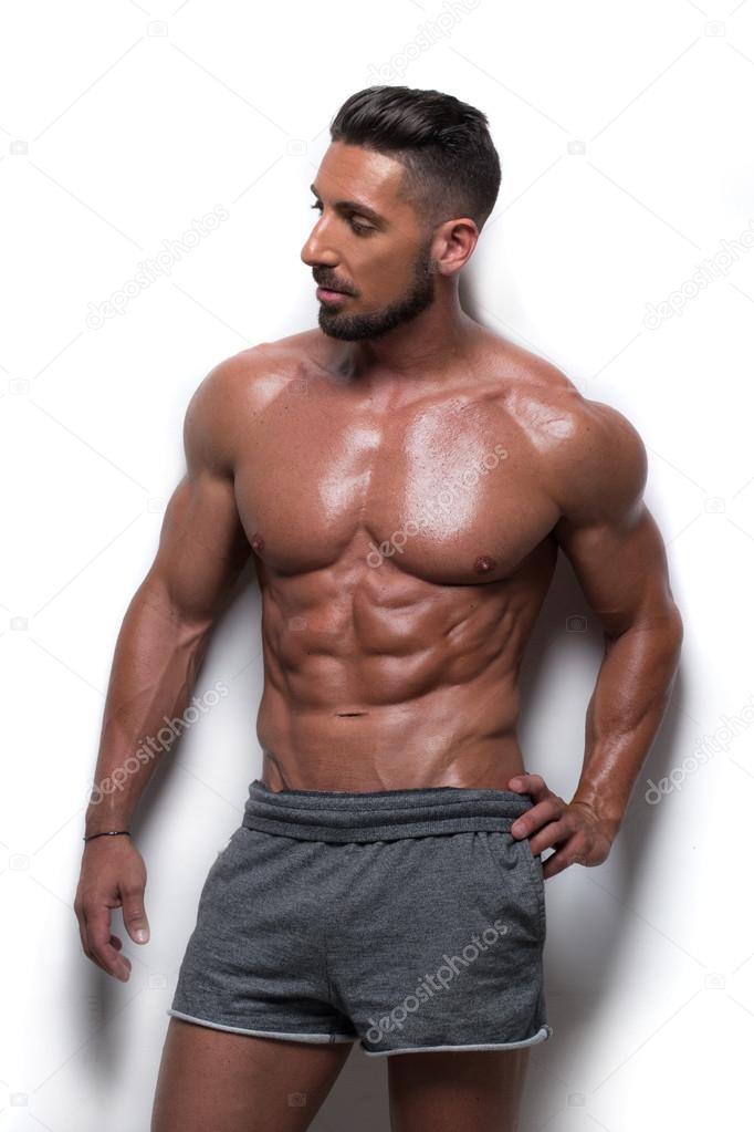 Muscular Man Wearing Gray Athletic Shorts