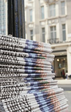 stack of the newspapers in the city