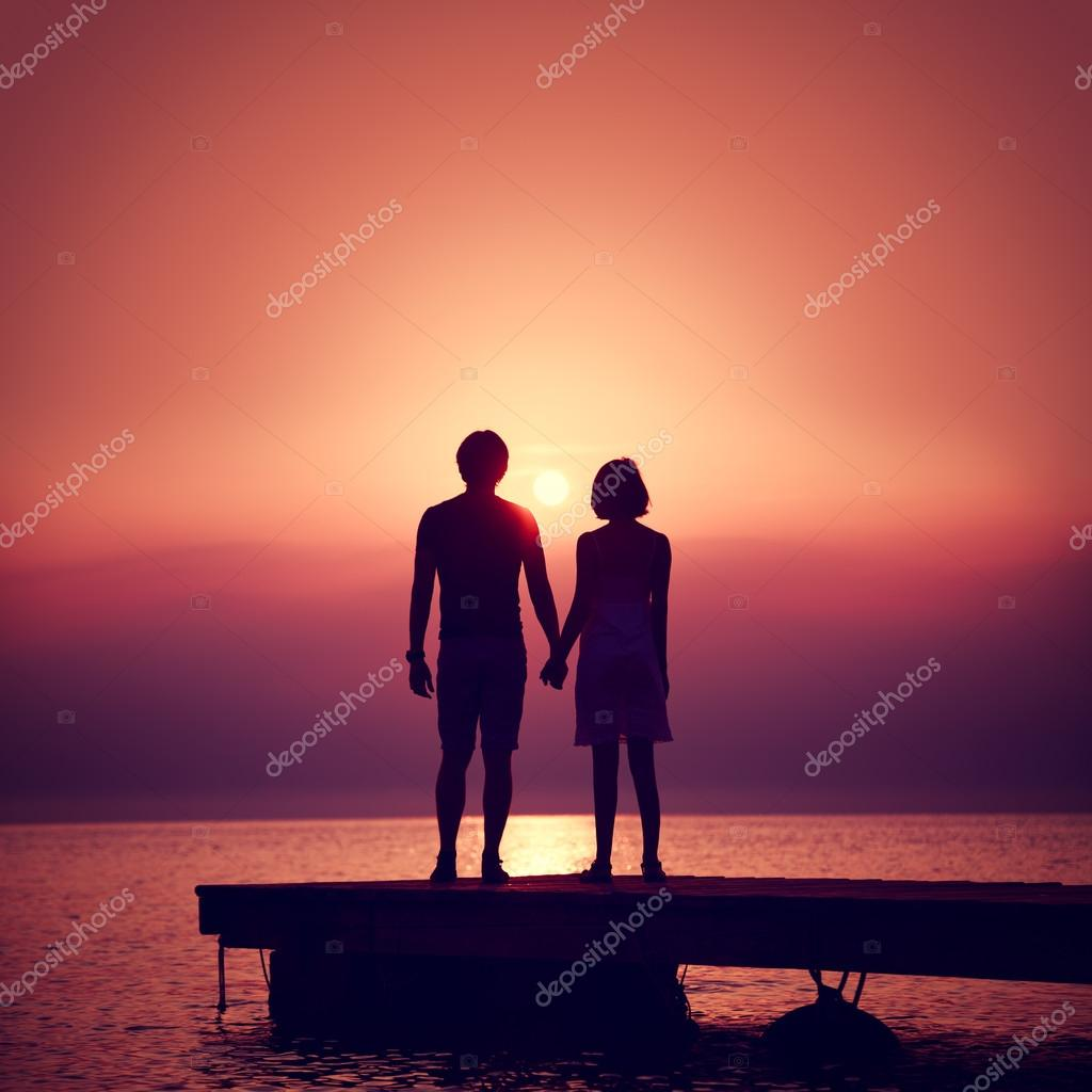 Romantic Couple Enjoying Sunset at Sea.