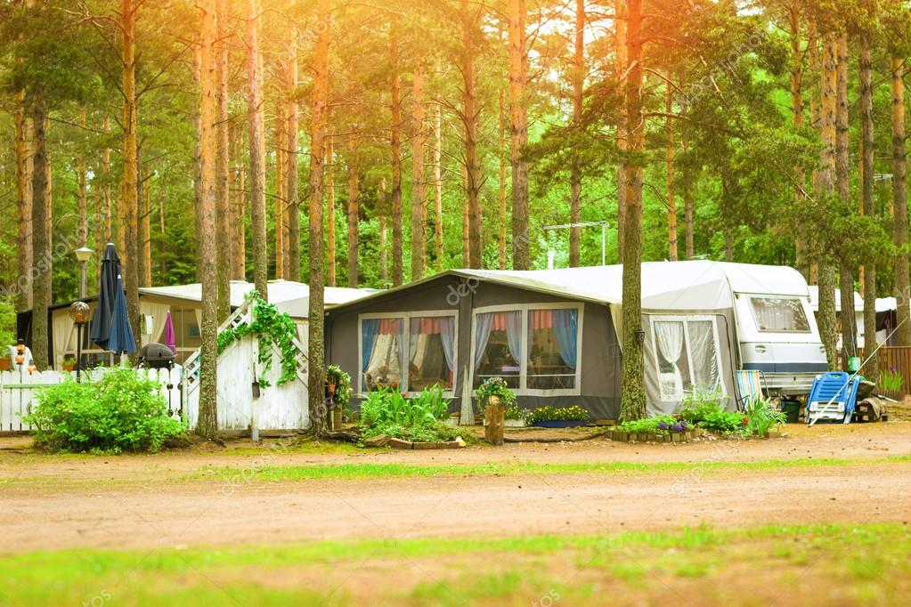 Camping vans and tents in wooded campsite. Hamina, Finland, Suomi