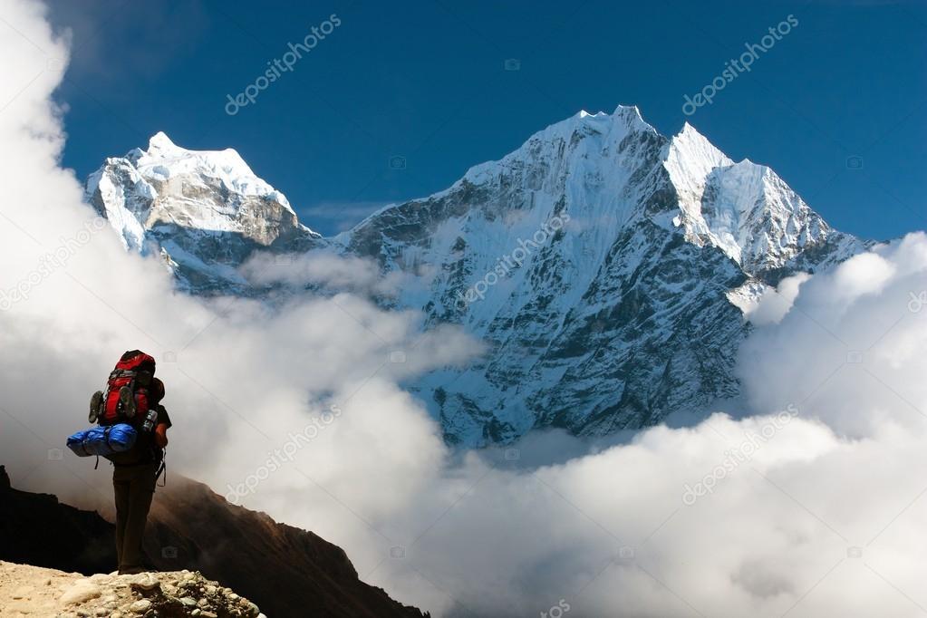 Kangtega and Thamserku with tourist - beautiful mounts above the Namche Bazar on the way to Everest Base Camp - Nepal