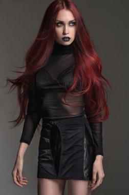 woman in short black dress