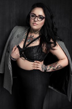 woman in glasses with  tattoo on chest