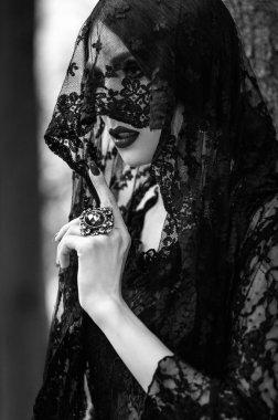 woman in black lace dress