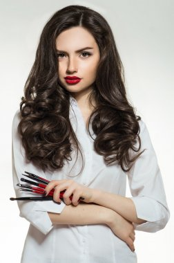 Woman with professional makeup brushes