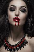 Fotografie Porträt einer gotischen Vampir-Frau
