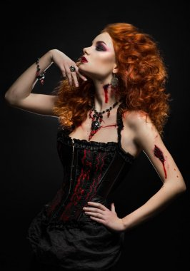 Redhead woman with wounds