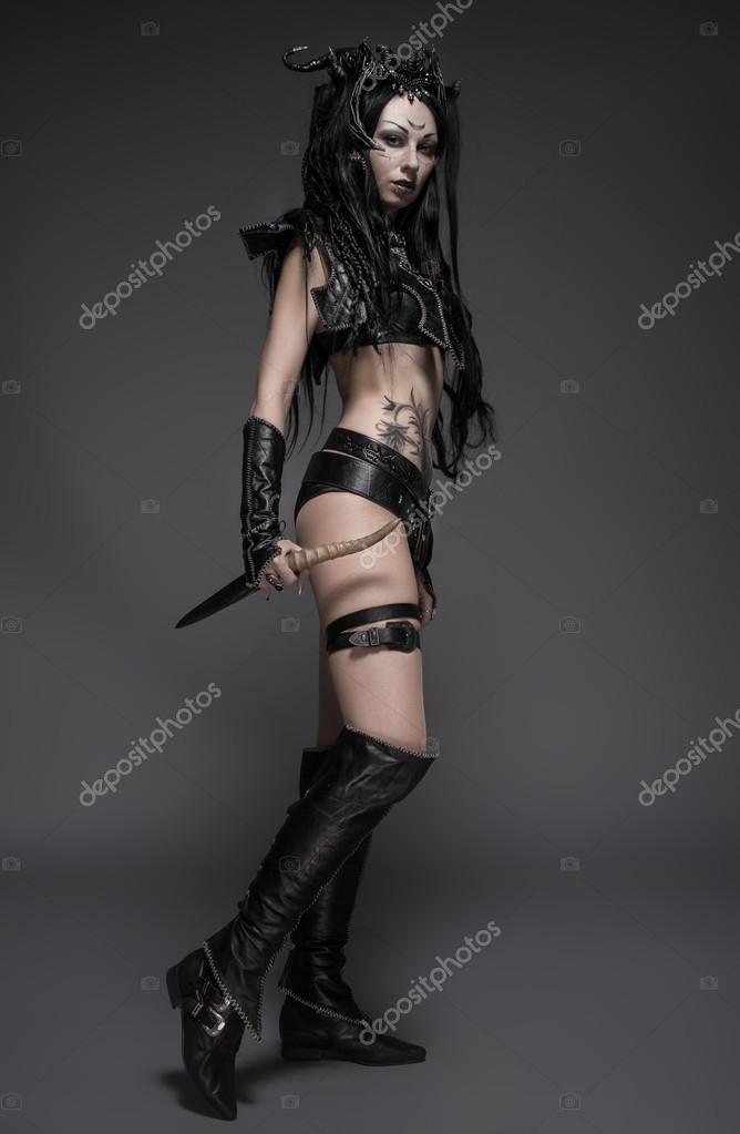 Woman warrior holding sword in hands