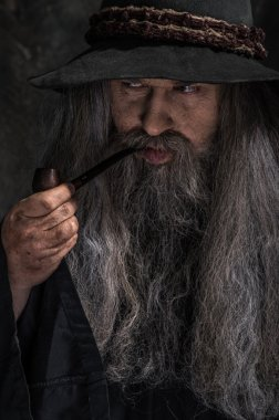 Old sorcerer smoking a pipe
