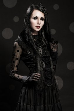 Girl-alien with black eyes