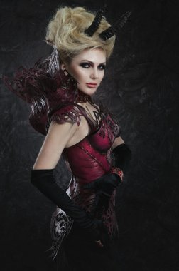 Portrait of beautiful devil woman