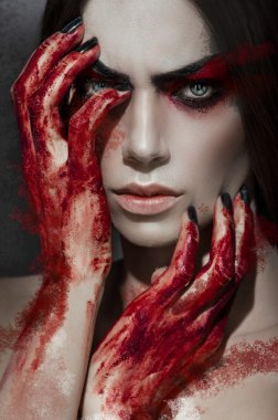 portrait of    woman with bloody hands