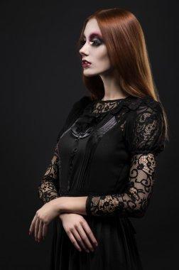 gothic girl in dark clothes