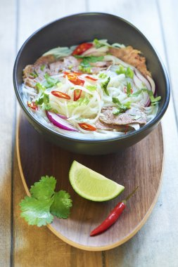 Pho bo, rice noodle soup with sliced beef