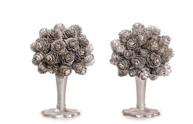 Silver topiary made from fir nob over white background