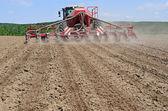 Fotografie Planting corn trailed planter in the field