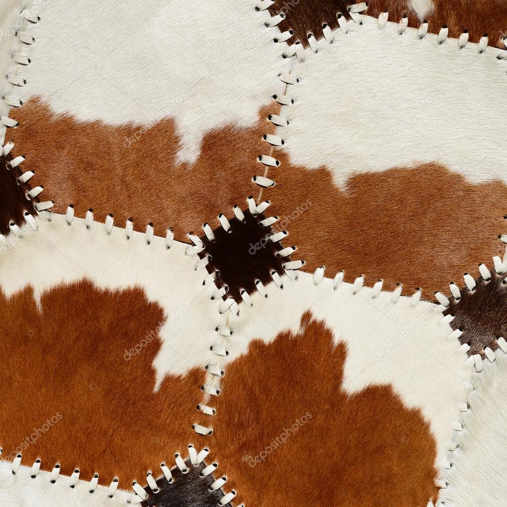 Dettaglio da tappeto di pelle di mucca — Foto Stock © smereka #123391902