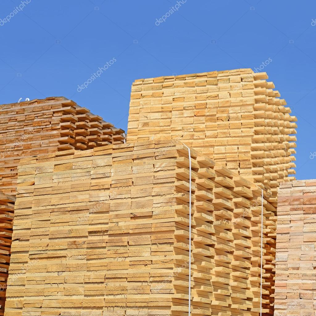 An edging board in stacks in an industrial landscape