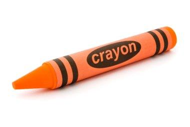 Single orange crayon isolated on white