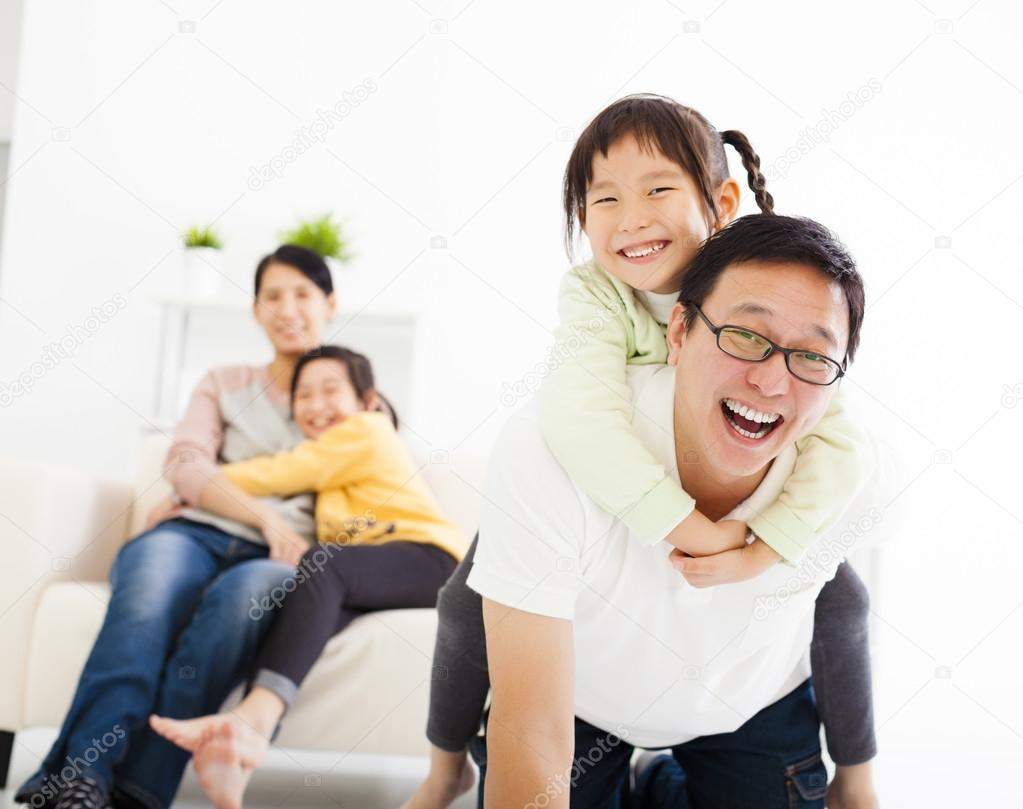 happy asian family in the living room — Stock Photo © tomwang #58760167