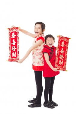 asian little girls showing couplets for happy chinese new year