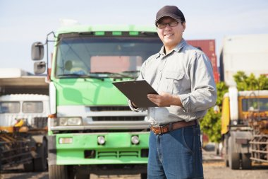 happy truck driver writing on a document