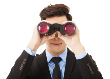 Businessman looking through binoculars and searching