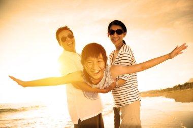 happy family enjoy summer vacation on the beach