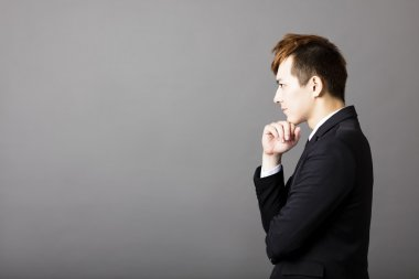 side view of young businessman thinking