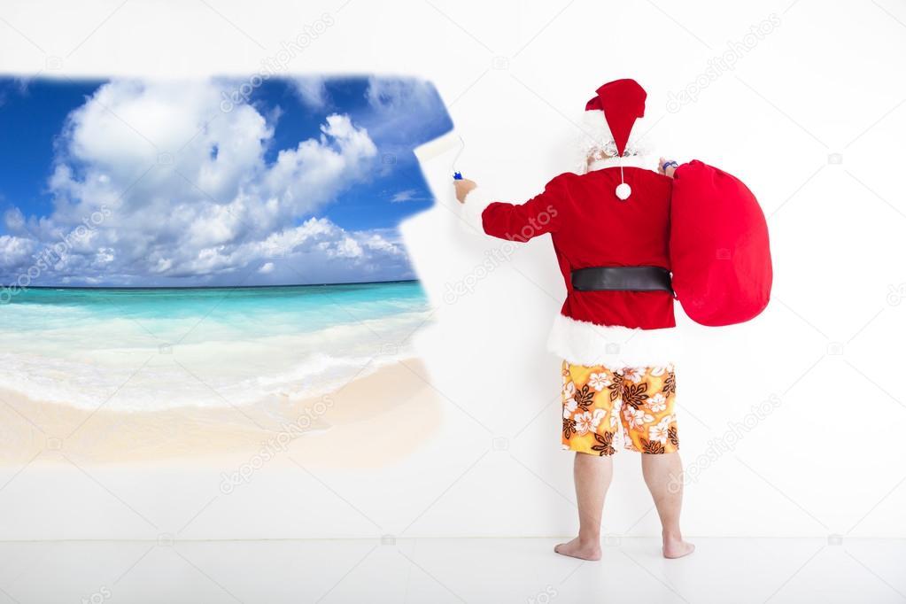 68d04b8e6460 Άγιος Βασίλης με μαγιό και ζωγραφική έννοια διακοπές στον τοίχο– εικόνα  αρχείου