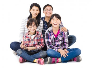 happy asian family sitting together