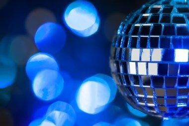 Beautiful disco ball on dark bokeh background