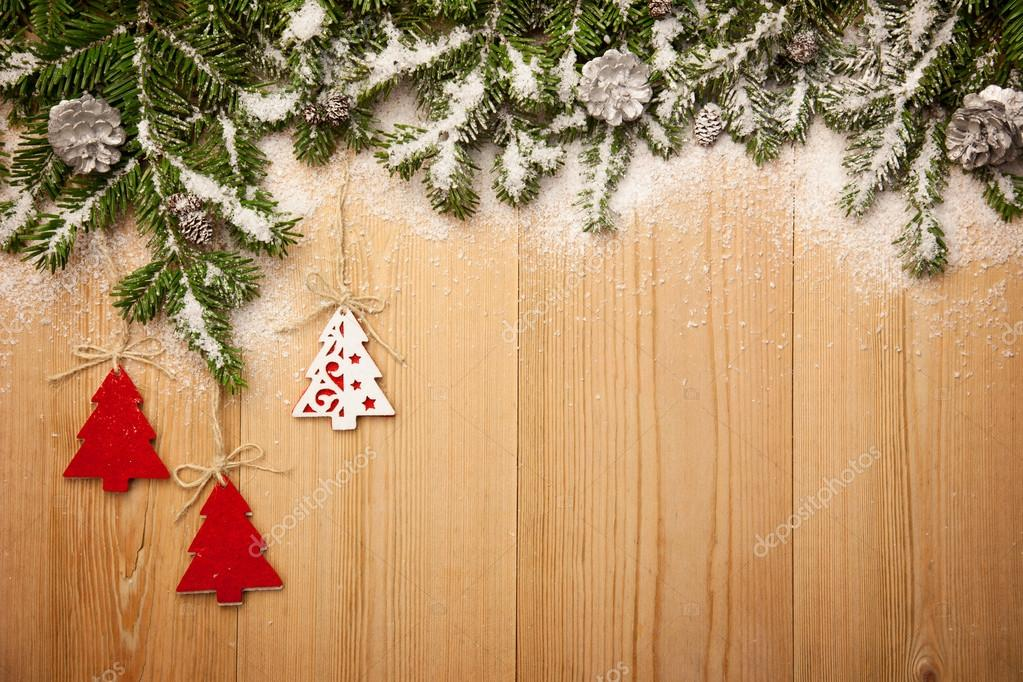 Christmas background with firtree, decorative trees and cones on