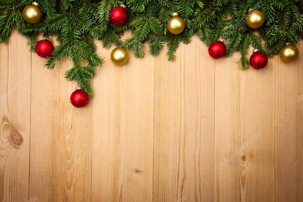 Christmas background with firtree and baubles on wood