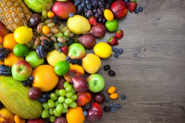 Mix of Fresh Fruits  on dark wooden table