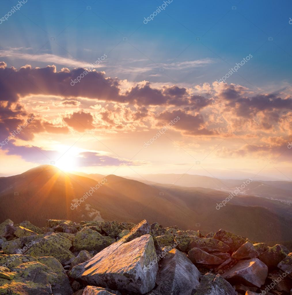 Beautiful sunset in the mountains landscape. Dramatic sky and co