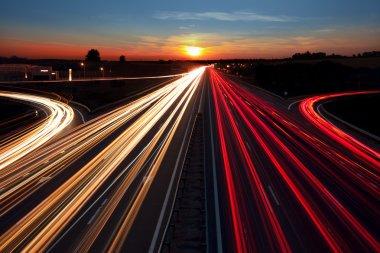 Speed Traffic  long exposure on  highway at sundown time