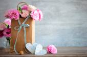 Fotografie Love background with roses flowers and bow