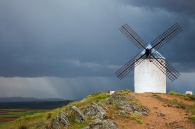 Old  Windmill on dramatic sky and rain