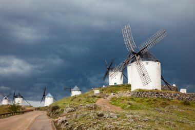Old  windmills on dramatic sky and rainy weather