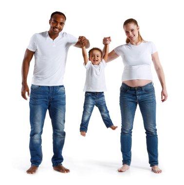 Happy joyful parents having fun with his son.