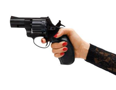Revolver in hand. Studio photography of woman's hand holding handgun