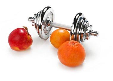 Red apple, orange citrus and dumbbell