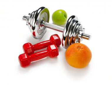 Light and Heavy dumbbells with green apple ang grapefruit
