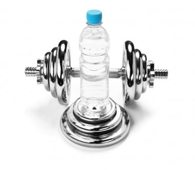Water bottle and a dumbbell, fitness concept