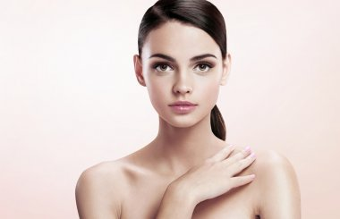 Pretty young lady with professional make-up, skin care concept